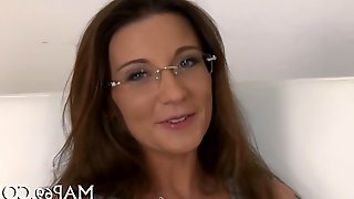 Euro redhead with glasses teases and fucks for cash in bed