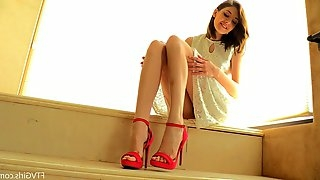 Adventurous babe with sexy legs inserting high heels in her juicy pussy
