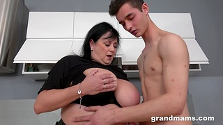 Brunette BBW lets a young guy drill her wet pussy on the floor